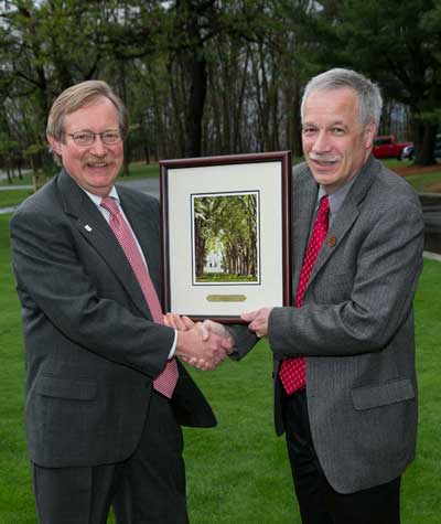 Jim Guldin (right) receives Outstanding Alumni Award from Mike Messina (left). Photo courtesy of the Pennsylvania State University.