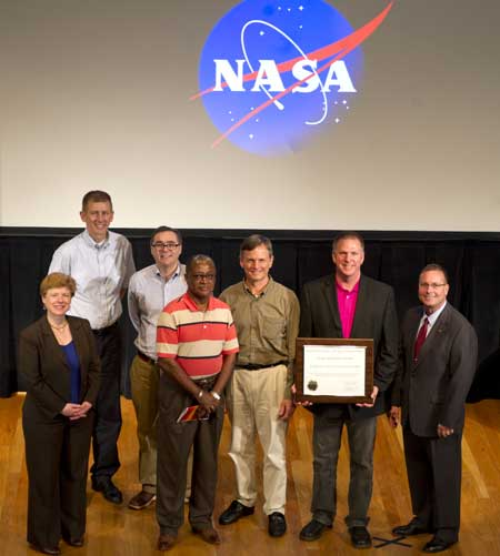 NASA Team-Jerry Gasser, Joe Spruce, James Smoot,Phil Kuper, and Bill Graham--accepting the award on behalf of the interagency/university ForWarn development team. Photo by NASA.