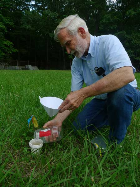 SRS research forester Henry McNab explains how bees are collected. Photo by Sarah Farmer.