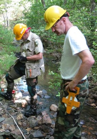 Researchers survey a stream crossing. Photo by Virginia McDaniels, U.S. Forest Service.