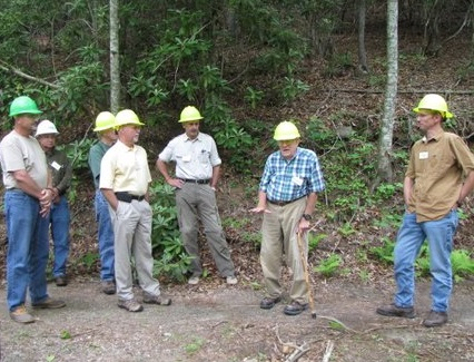 Lloyd Swift shares his wisdom about building and maintaining forest roads. Photo by U.S. Forest Service.