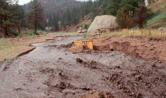 One consequence of wildfire is the increased probability of flash floods. Photo by John A. Moody, courtesy of USGS.