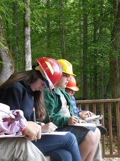 Other students experiment with sketching outdoors. Photo by U.S. Forest Service.