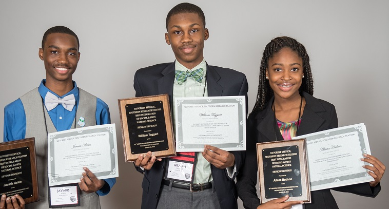 Westlake High School students Javaris Askin, William Taggart and Allana Hudson display their SRS-sponsored awards. Photo courtesy of UGA.