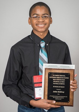 Piney Grove Middle School student Jaden McElvey displays the award he won in the Environmental Sciences category. Photo courtesy of UGA.