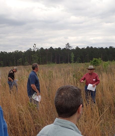 Dave Haywood, retired Forest Service scientist, shares his knowledge about using prescribed fire to manage longleaf pine stands in the western Gulf region. Photo by U.S. Forest Service.