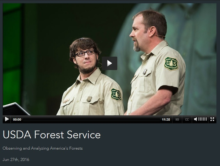 "Forest Service researchers Chris Oswalt (right) and Charles ""Hobie"" Perry presenting a plenary session at the Esri Users Conference."