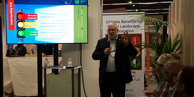 Forest Service scientist John Stanturf presents the spotlight tool at the Global Landscapes Forum in Paris. Photo by Gerda Wolfrum.