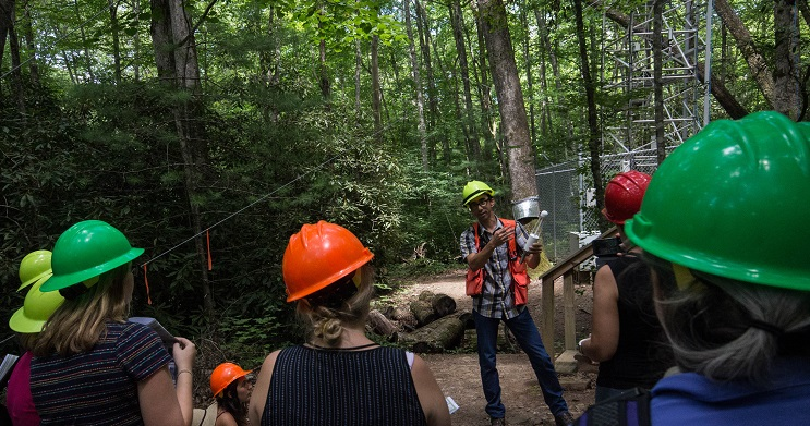 """Chris Oishi, research ecologist at the SRS Coweeta Hydrologic Laboratory, talks with journalists about findings from the experimental forest's """"electric forest."""" Photo by Sarah Farmer, U.S. Forest Service."""