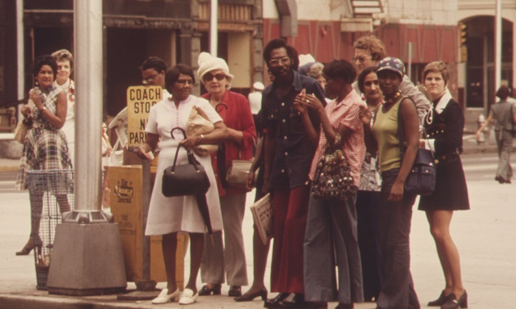 Commuters wait for the bus in downtown Atlanta, 1974. In 2010, about 70 percent of MARTA passengers were African American. Photo by Jim Pickerell, National Archives and Records Administration. Courtesy of Wikimedia Commons.