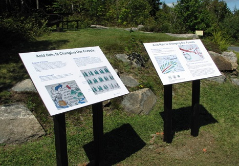 Faded and weathered interpretive panels describing acid rain research on Mount Ascutney were replaced in 2016. Photo by Johnny Boggs, U.S. Forest Service.