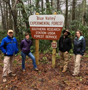 four people at the Blue Valley Experimental Forest