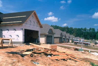 photo: new housing construction with pines in the background